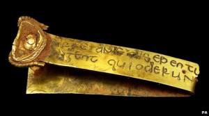Biblical inscription in Latin on a gold strip